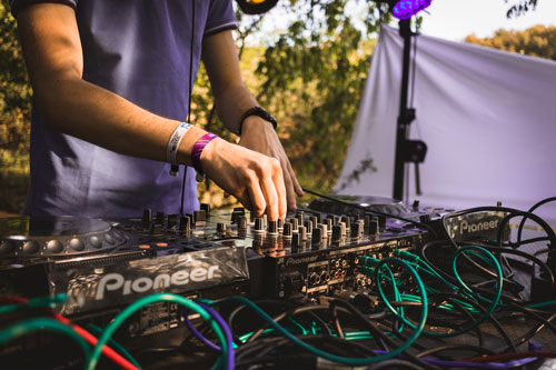 young man at DJ table on stage